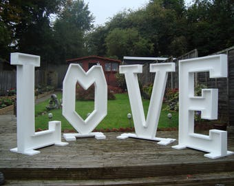 Large Solid Letters spelling love for wedding day for sale free postage in the uk