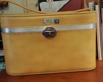 Vintage Amelia Earhart train case yellow.