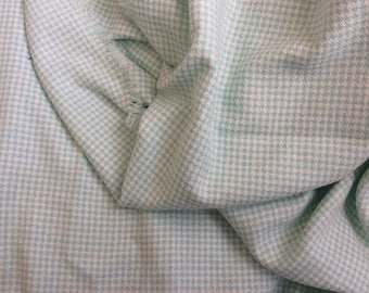 Green fabric water and white houndstooth