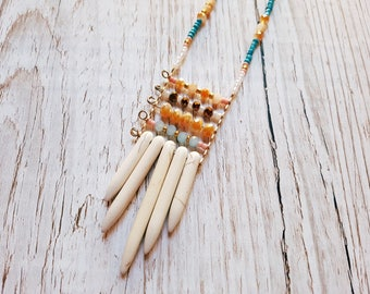 Technical necklace round beads and long gold and ivory