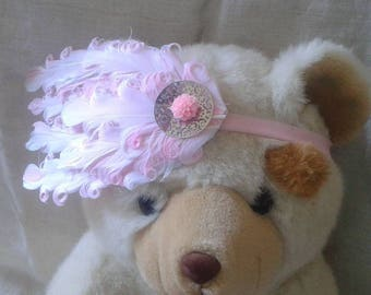 headband pink and white feathers adorned with a flower