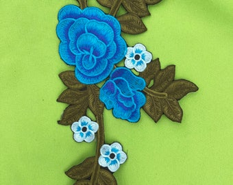 Big Embroider Flower Patch Iron on it.