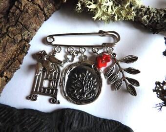 Silver brooch: cage, Messenger bird, flower, key, leaf pendant effect wax tree pattern.