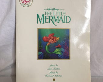 1990 Disney The Little Mermaid sheet music book.