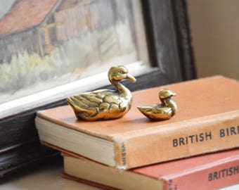 Two minature brass ducks