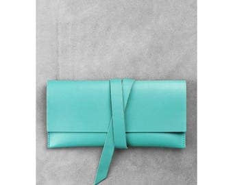 Leather travel wallet, passport holder, ticket holder, map holder. Tiffany colour