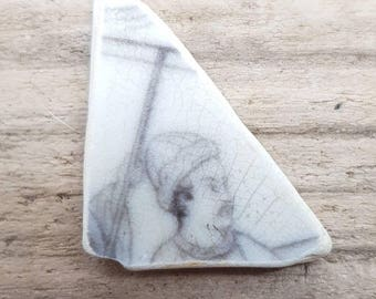 Sea worn pottery piece with a   figure on frount,unusal piece of sea pottery,pendant size,smoith all over,genuine beach find.