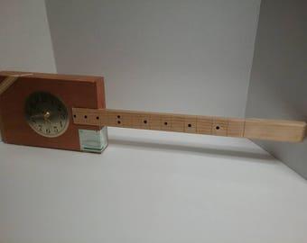 Cigar box guitar clock