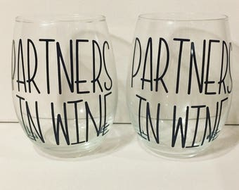 Partners in wine glasses