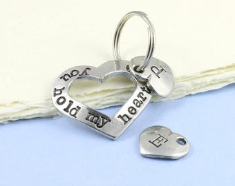 Cut Out Heart Keyring in Pewter with the message You hold my Heart hand stamped around it makes a gift of love.