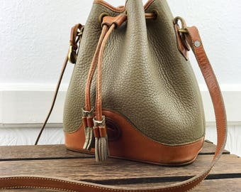 Dooney & Bourke Distressed Tan AWL and Brown Leather Trim Bucket Shoulder Bag Made in U.S.A.