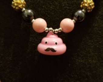 Pink poopster emoji necklace.
