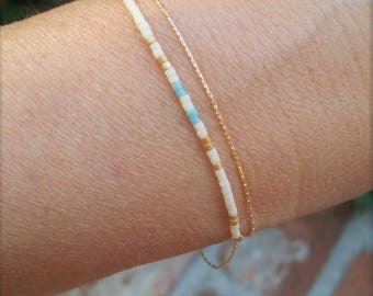 Delicate multi layered minimalist beaded bracelet.  Gold filled and made with love.  Double chain with turquoise, white and gold beads.
