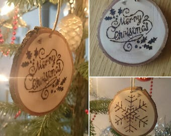 Christmas bauble on wooden disc