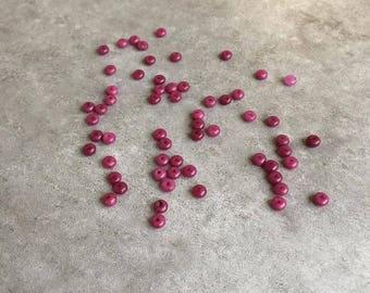 Set of purple resin beads