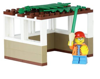 LEGO® Sukkah with boy holding a Lulav and Esrog - Jewish Custom Lego® Set from JBrick