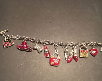 Silver and red charm bracelet