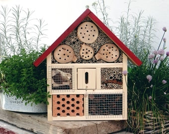 Insect Hotel established in handmade - roof red - clay tile