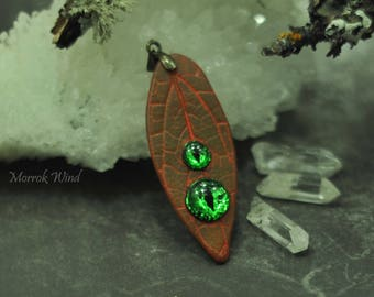 Watching   forest necklace . Surreal pendant - leaf  with glowing eyes made of resin.