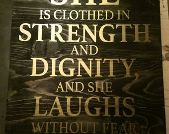 She is clothed in strength and dignity....
