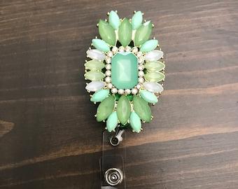 Green jewel retractable badge clip