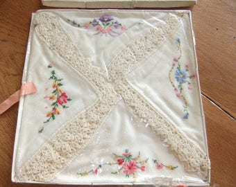 Boxed set of 1950,s cotton and lace embroidered handkerchiefs set of four unused
