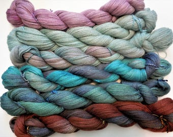 100% Baby Alpaca Lace weight Hand dyed . Soft and light weight.
