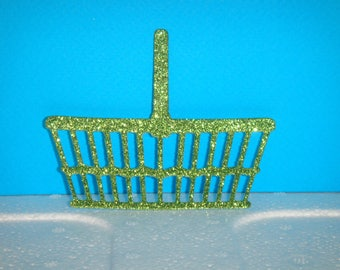 Cut green glitter for scrapbooking and card basket