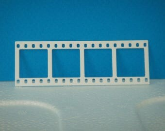 Cut little white film for scrapbooking and card