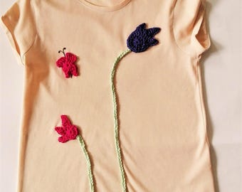 t-shirt with handmade crocheted application.