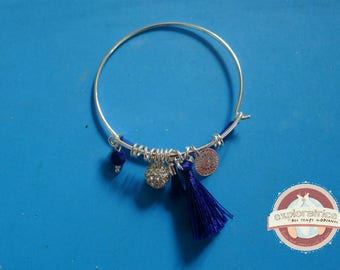 Bangle is silver and blue rhinestone tassel