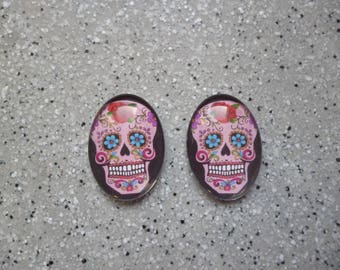 2 oval cabochons pictured skull glass 18 x 25 mm