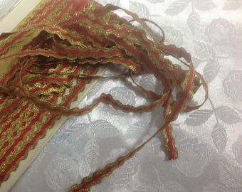 Small gold and red, fairly rigid lace