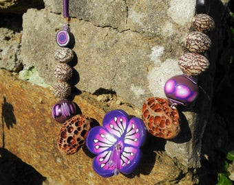 exotic purple flower necklace