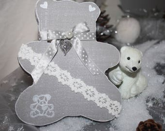 Plaster decorated hanging bear.