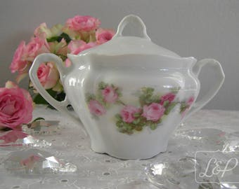 Shabby candle in a former n2 roses decor porcelain sugar bowl