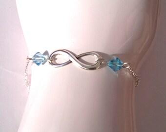 Infinity bracelet, and blue Swarovski pearls