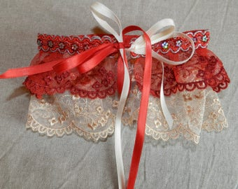 Red satin ribbon and glitter lace garter