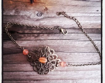 Anklet in antique bronze filigree and orange glass beads