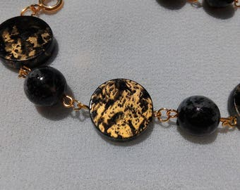 Synthetic black and gold bracelet