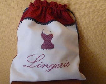 Elegant red and blue lingerie bag Navy embroidered on unbleached canvas