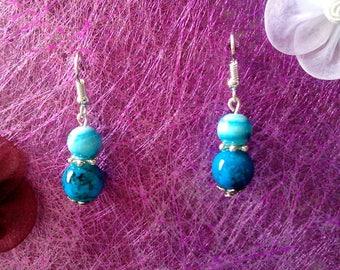 pair of blue earrings