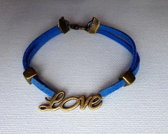 Love bracelet bronze and indigo blue suede leather cord.