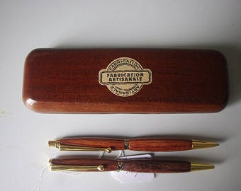 Gold and worn plaquqe wooden pen box mines