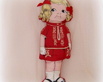 Doll cloth in red fabric with satin bow