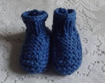 Blue baby booties, baby.