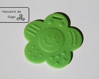 Teething ring, flower face shape green.