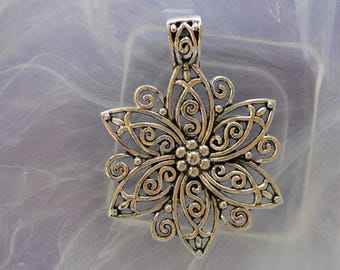 large silver metal flower pendant
