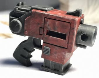 3D Printed Bolter Pistol Prop Based on the Warhammer 40k Fictional Weapon