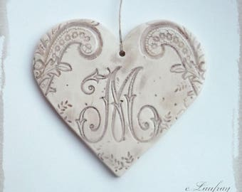 Large heart impressions and faience lace hanging, brown beige color, letter ' I